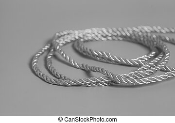 Silver rope on gray background