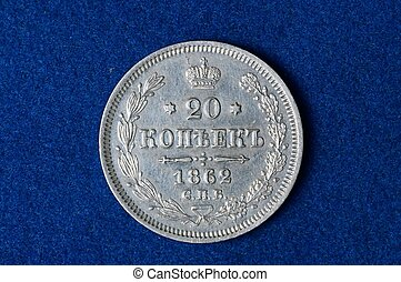 silver russian coin on a blue background