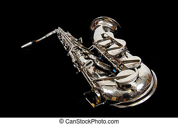 silver saxophone isolated on the black background
