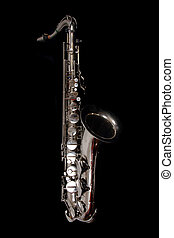 silver saxopphone isolated on the black background