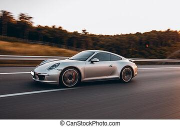Silver sedan on the mountain roads, extreme motion