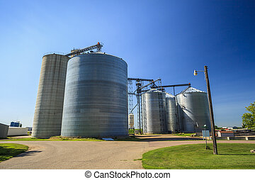 Silver, shiny agricultural silos.