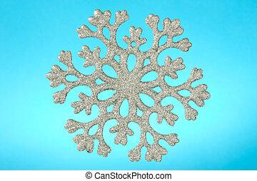 snowflake isolated on blue background