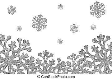 Silver shiny snowflakes fall