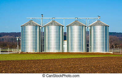silver silo in rural landscape