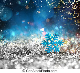 Silver sparkly crystal with snowflake background