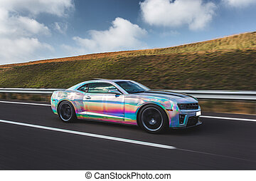 Silver sport car with colorful autotuning on the road