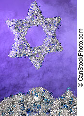 silver Star of David on blue foggy background with garlin