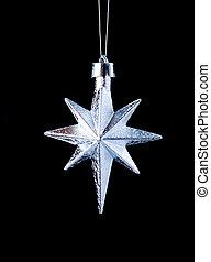 silver star on black background