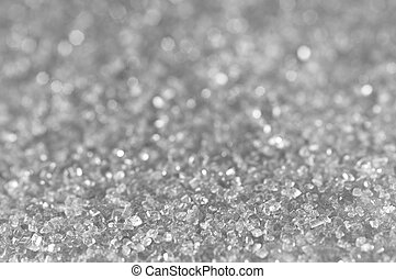 Silver sugar sparkle background with focus in the front