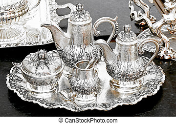Old luxurious silver tea set at tray