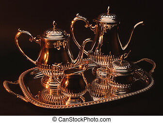 Silver teapot set against a black background