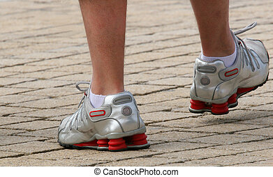 Silver Trainer Comfort - Lower legs and feet of a man ...