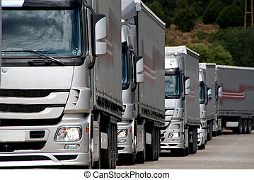 Silver truck convoy approacing at viewer