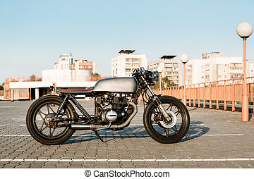 Silver vintage custom motorcycle cafe racer