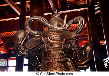 Silver Warrior in Wooden Hall Jing An Temple Shanghai China...