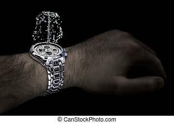 Silver watch with fountain on the wrist of man