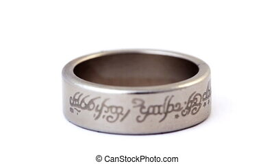 silver wedding ring with engraved ancient inscriptions rotating