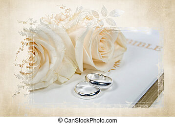 wedding rings on Holy Bible - Silver wedding rings on Holy...