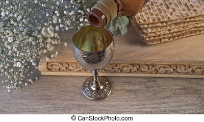 Silver wine cup with matzah, Jewish symbols for the Passover...