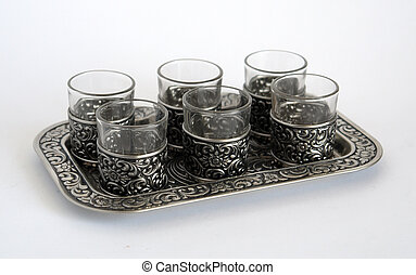 Silver wine-glasses with pattern on a tray