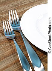 Silverware - Modern silverware arranged in a place setting...