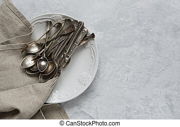 Silverware on a ceramic plate