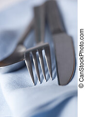 Silverware on Blue Napkin