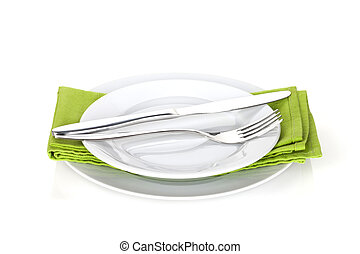 Silverware or flatware set of fork, spoons and knife on plates