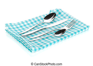 Silverware or flatware set of fork, spoons and knife on towel