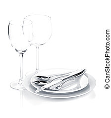 Silverware or flatware set over plates and wine glasses....