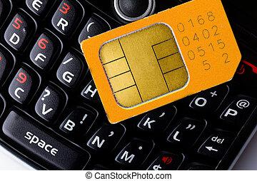 Sim card on smart phone keyboard