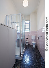 Simple bathroom interior with pink tiles