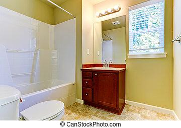 Simple bathroom interior with vanity cabinet and mirror