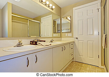 Simple bathroom interior with white cabinets