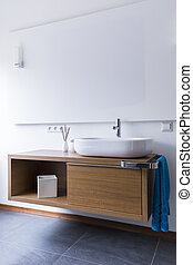 Simple bathroom with washbasin and cabinets