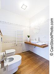 Simple bathroom with wooden floor
