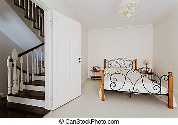 Simple bedroom and wooden stairs