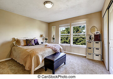 Simple bedroom interior with window. Furnished with bed, ottoman and storage unit