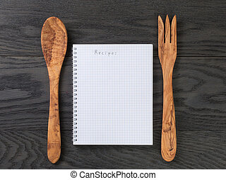simple blank notepad with word recipe on rustic wood table, background