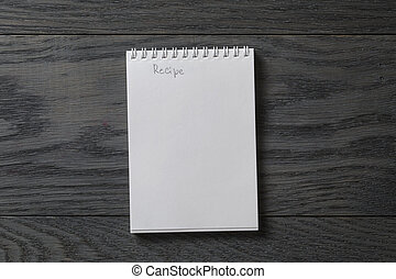 simple blank notepad with word recipe on rustic wood table