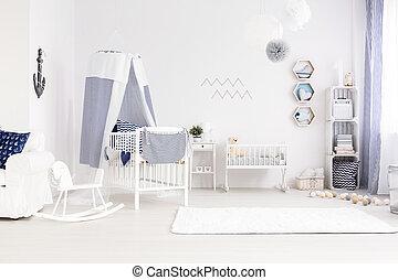 Simple but tasteful room awaiting a newborn