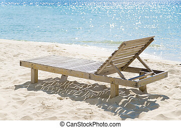Simple chair at beach with bokeh background