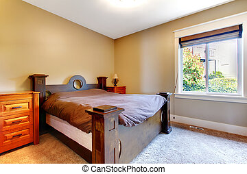 Simple classic new bedrom with nice bed and dresser.