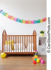 Simple cot in light interior - Picture of simple wooden baby...