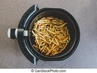 simple food ingredients concept, french fries cooked in an air fryer