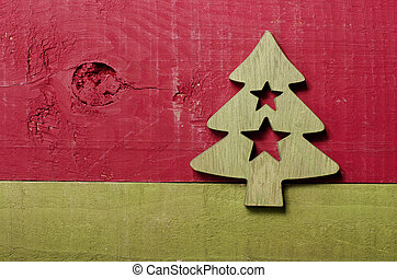 Simple green Christmas tree with stars on a green and red wooden background.