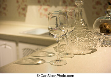 Simple home table setting, glasses in the kitchen interior.