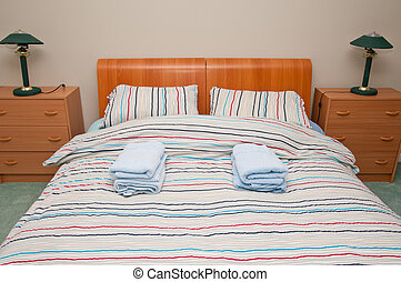 Simple and generic looking hostel or hotel accommodation with comfortable bedding.