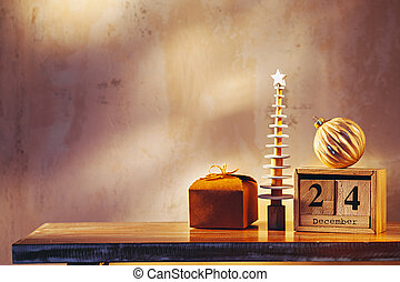 Simple image with christmas tree, gift, ornament and wooden calendar